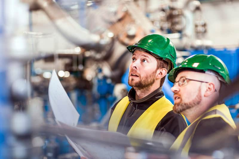 Two Engineers looking at a factory