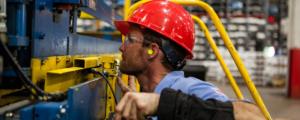 Employee Working Heavy Machinery